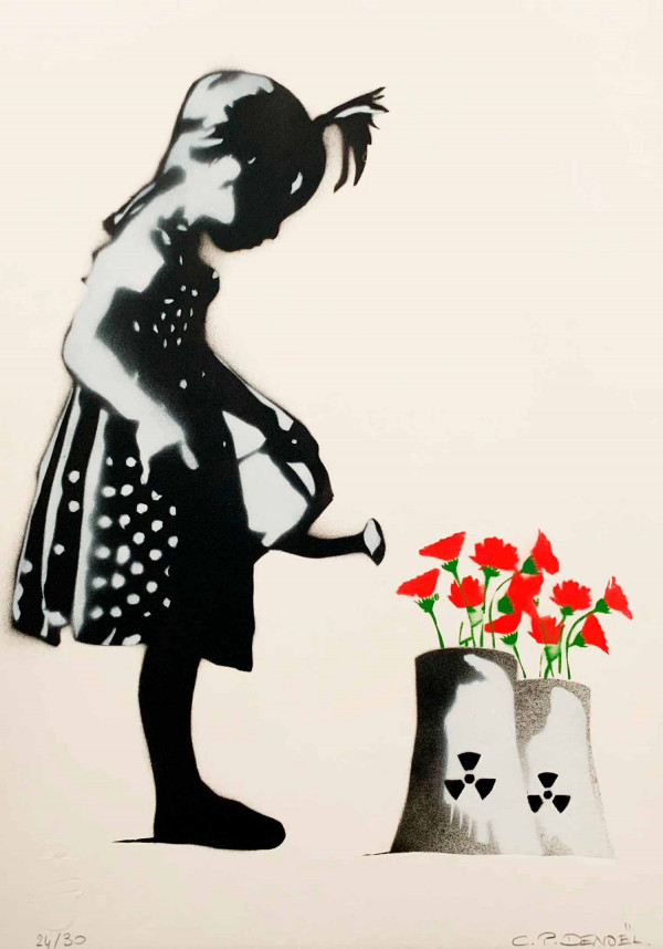 Little girl with a watering can